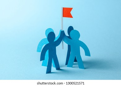 Business team and red flag with goal. The team seeks to achieve the goal.
