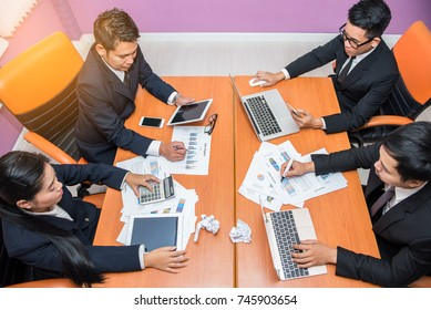 Business team reviewing financial reports in the office.