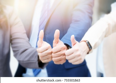 Business team show thumb up gesture, Like Concept