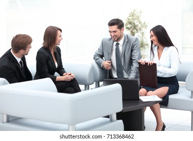 business team sitting in the lobby of the office