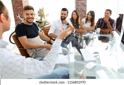 business team sitting at a modern Desk.