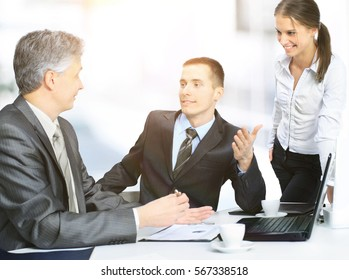 Business team sitting in office and planning work debating among themselves
