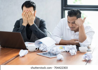 Business team sitting sad and solving problem in office.Unhappy and depressed from rejection project plan. Stress and disappointment in business strategy.business, teamwork, people and crisis concept