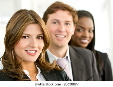 business team smiling in an office - diversity