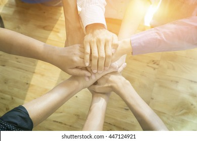 Business team standing hands together in the office. people joining  altogether, simultaneously, abreast, cooperation success business Teamwork, concept,vintage color