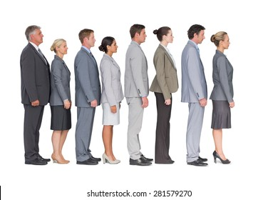 Business team standing in row on white background