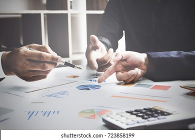 Business team support and meeting concept. Group of Investor working and pointing at financial paperwork Finance task.