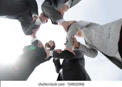 business team are taking each other's hands