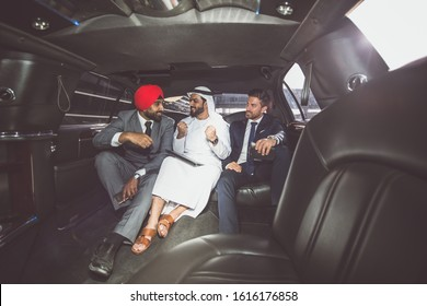 Business team talking about future plans in Dubai in the limousine