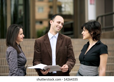 business team talking at staff meeting outdoors an office building in Cluj-Napoca