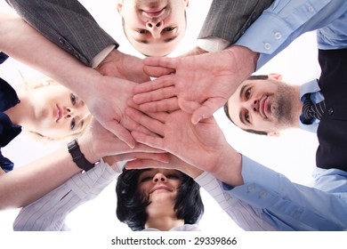 Business team with their hands together over white