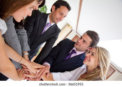 Business team with their hands together in the middle