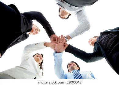 Business team with their hands together in the middle isolated over white