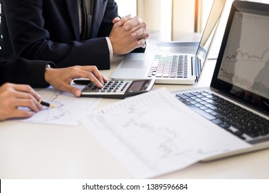 Business Team trader or broker Investment Entrepreneur colleagues working discussing and analysis graph stock market trading with forex chart data, financial, selling and buying concept.