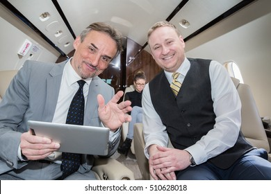 business team traveling in corporate airplane