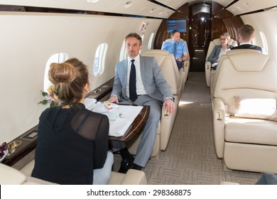 business team traveling in corporate jet