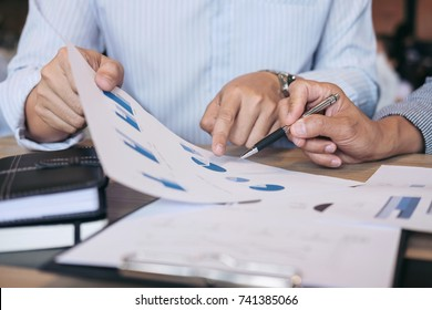Business team two executive colleagues discussing and analysis working Financial investment on calculator with calculate on tablet Analyze business and market growth on financial document data graph.