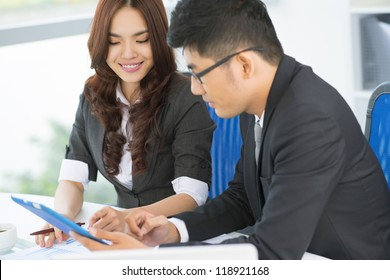 Business team of two making use of modern technology to solve business problems