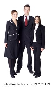 Business team with two women and one man looking friendly into the camera.