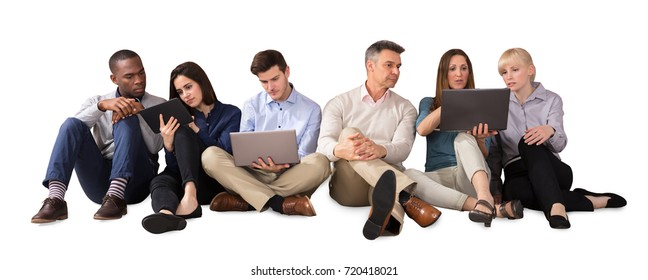 Business Team Using Electronic Devices Against White Background