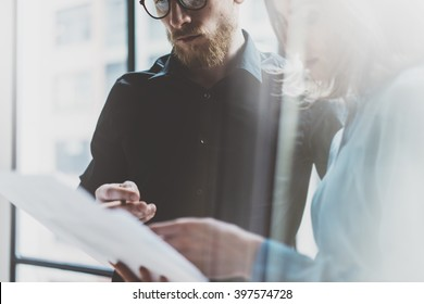 Business team work process modern office.Photo professional crew working with new startup project. Project managers meeting. Analyze  plans.Coworking world. Blurred background, film effect.Horizontal