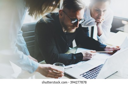 Business team work process. Photo young professionals crew working with new startup project. Project managers meeting. Presentation business plans laptop. Blurred background, film effect. Horizontal