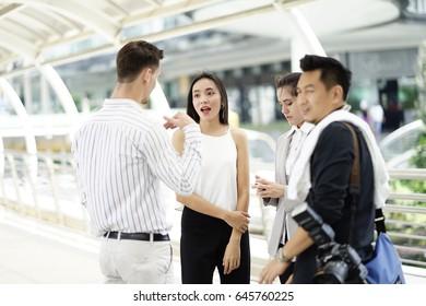 business team work talk to photographer