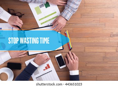 BUSINESS TEAM WORKING OFFICE STOP WASTING TIME DESK CONCEPT