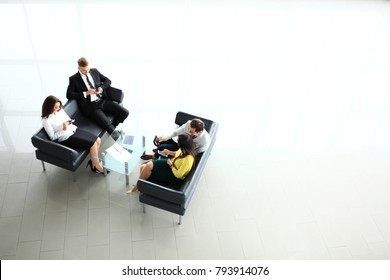 Business team working on report, view from the top