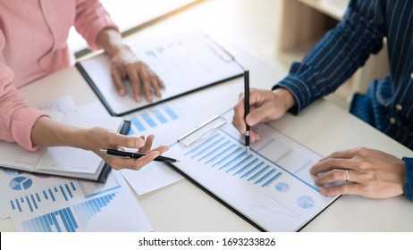Business team working with plan on office desk with new startup project analyzing financial document data charts and graphs in Meeting and successful teamwork Concept