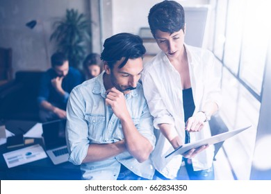 Business team at working process.Young professionals work with new crafting startup.Project managers meeting.Panoramic windows on blurred background.Horizontal