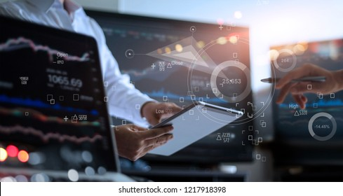 Business team working together. Businessman analyzing data stock market in monitoring room on the data presented in the chart, forex trading graph, stock exchange trading online, financial investment