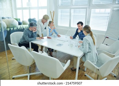 Business team working together in conference room of the office