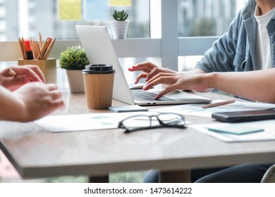 Business team working together with laptop at office. Business concept