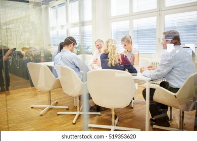 Business team working together in a meeting in a conference room