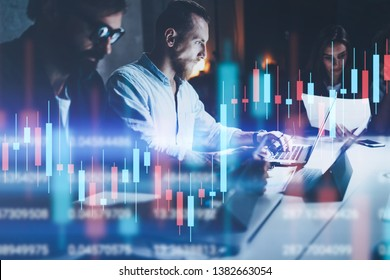 Business team working together at night office.Technical price graph and indicator, red and green candlestick chart and stock trading computer screen background. Double exposure.