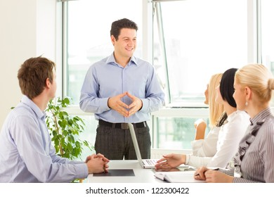 Business teamleader looks self contented after presentation