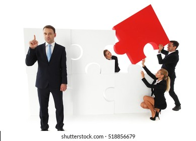 Business teamwork building big puzzle isolated on white background