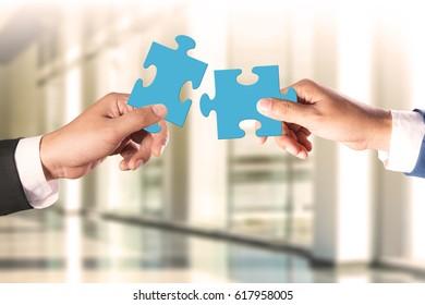 Business teamwork concept, businessman holding jigsaw puzzle concept