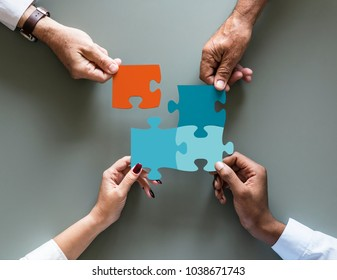 Business teamwork cooperation jigsaw isolated