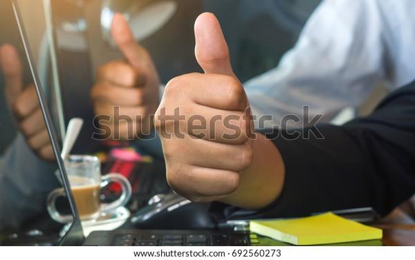 business teamwork giving thumbs up