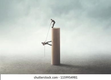 business teamwork help concept; man help friend to climb