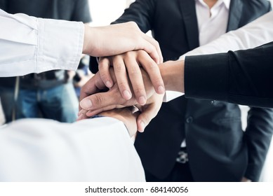 Business teamwork. Business man coworkers with joined hands together represent unity. Dedication and teamwork lead to success