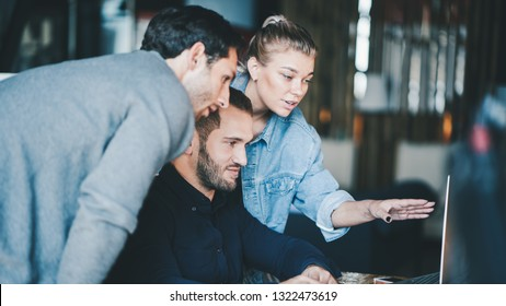 Business teamwork situation. Group of three people discussing daily flow in the office