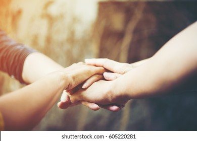 Business teamwork standing hands together.