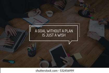BUSINESS TEAMWORK WORKING OFFICE BRAINSTORMING A GOAL WITHOUT A PLAN IS JUST A WISH CONCEPT