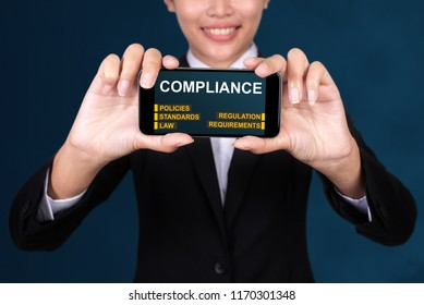 Business Technology concept, Happy businesswoman Show text Compliance on Smart Phone.