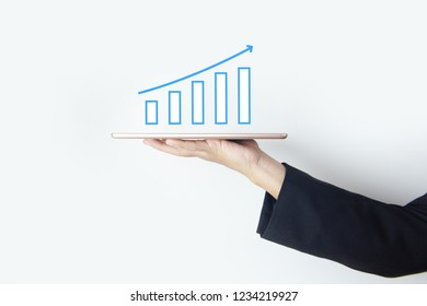 Business and Technology concept illustration on photo with stock market business graph is growth up and business man is handling tablet on white background.