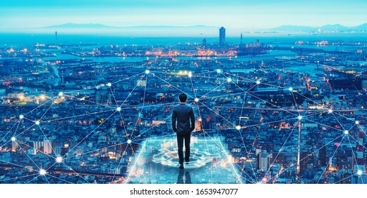 Business technology concept, Professional business man walking on future network city background and futuristic interface graphic at night, Cyberpunk color style