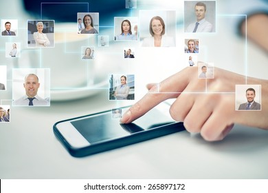 business, technology, global communication and people concept - close up of woman hand with smartphone and contact icons projection